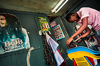 A Colombian hairdresser cuts a boys's hair in a barber shop in Tumaco, Colombia, 18 June 2010.