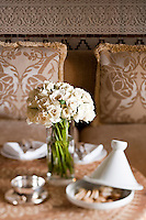Moroccan pastry served in a bedroom with a bunch of freshly cut white roses