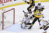 8th June 2017, Pittsburgh, PA, USA; Pittsburgh Penguins defenseman Ron Hainsey (65) scores past Nashville Predators goalie Juuse Saros (74) during the second period in Game Five of the 2017 NHL Stanley Cup Final between the Nashville Predators and the Pittsburgh Penguins on June 8, 2017, at PPG Paints Arena