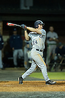 Kyle Smith (24) of the Catawba Indians follows through on his swing against the Belmont Abbey Crusaders at Abbey Yard on February 7, 2017 in Belmont, North Carolina.  The Crusaders defeated the Indians 12-9.  (Brian Westerholt/Four Seam Images)