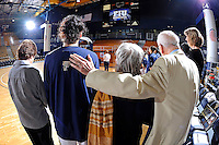 25 February 2012:  FIU senior guard Fanni Hutlassa (10), pictured with her grandparents and Head Coach Cindy Russo, stand for the playing of the Hungarian National Anthem during a ceremony honoring seniors prior to the start of the game.  The FIU Golden Panthers defeated the University of South Alabama Jaguars, 58-55 (OT), at the U.S. Century Bank Arena in Miami, Florida.