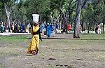 A woman carries water on her head in the Yusuf Batil refugee camp in South Sudan's Upper Nile State. More than 110,000 refugees were living in four camps in Maban County in October 2012, but officials expected more would arrive once the rainy season ended and people could cross rivers that block the routes from Sudan's Blue Nile area, where Sudanese military has been bombing civilian populations as part of its response to a local insurgency. Conditions in the camps are often grim, with outbreaks of diseases such as Hepatitis E.