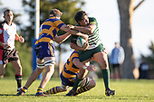 Howard Sililoto looks for support as he is tackled. Counties Manukau Premier Club Rugby game between Manurewa and Patumahoe, played at Mountfort Park Manurewa on Saturday June 23rd 2018. Patumahoe won the game 29 - 24 after trailing 12 - 19 at halftime.<br /> Manurewa Kidd Contracting 24 - Petelo Ikenasio, David Osofua, Paolelei Luteru, Pisi Leilua tries, Timothy Taefu 2 conversions,<br /> Patumahoe Troydon Patumahoe Hotel 29 - Kalim North, Shea Furniss, Jonny Wilkinson, Mark Royal, James Brady tries,  Broc Hooper 2 conversions.<br /> Photo by Richard Spranger