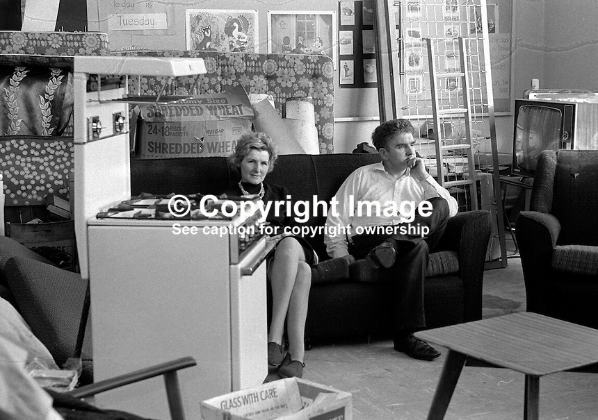 Roman Catholic couple who have evacuated from Chief Street, Belfast, N Ireland, UK, because of continuing rioting sit among their belongings in a local school hall. 197006000225b..Copyright Image from Victor Patterson, 54 Dorchester Park, Belfast, UK, BT9 6RJ..Tel: +44 28 9066 1296.Mob: +44 7802 353836.Voicemail +44 20 8816 7153.Skype: victorpattersonbelfast.Email: victorpatterson@me.com.Email: victorpatterson@ireland.com (back-up)..IMPORTANT: If you wish to use this image or any other of my images please go to www.victorpatterson.com and click on the Terms & Conditions. Then contact me by email or phone with the reference number(s) of the image(s) concerned.