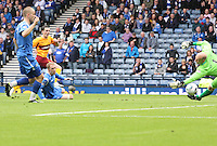 Jamie Murphy shoots past a despairing dive from Peter Enckelman to score
