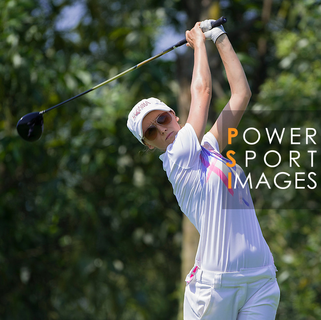 Players in action during the first day of the World Ladies Championship at the Mission Hills Haikou Sandbelt Trails course on 8 March 2013 in Hainan island, China . Photo by Manuel Queimadelos / The Power of Sport Images