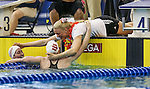 19 MAR 2016: Lilly King, center, and Miranda Tucker, left, are congratulated after finishing the 200 Yard Breaststroke final during the Division I Women's Swimming & Diving Championship held at the Georgia Tech Aquatic Center in Atlanta, GA. King posted an NCAA record time of 2:03.59. David Welker/NCAA Photos