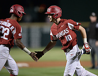 NWA Democrat-Gazette/ANDY SHUPE<br /> Arkansas designated hitter Matt Goodheart (10) slaps hands Friday, May 10, 2019, with pinch-runner Curtis Washington Jr. after Goodheart hit an RBI single during the eighth inning against LSU at Baum-Walker Stadium in Fayetteville. Visit nwadg.com/photos to see more photographs from the game.