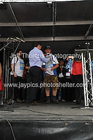 Peoples March for the NHS - Central London, Saturday 6th Sept 2014 - <br /> <br /> Shadow cabinet Health Minister Andy Burnham hands out medals to all the 300 mile marchers. <br /> <br /> <br /> <br /> <br /> Photographer: Jeff Thomas - Jeff Thomas Photography - 07837 386244/07837 216676 - www.jaypics.photoshelter.com - swansea1001@hotmail.co.uk
