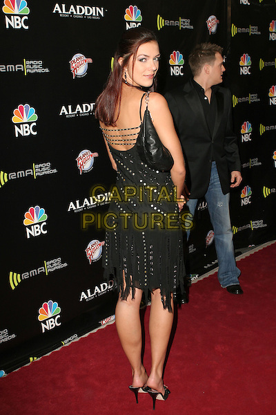 ADRIENNE CURRY.2005 Radio Music Awards - Arrivals held at the Aladdin Hotel, Las Vegas, Nevada..December 19th, 2005.Photo: Zach Lipp/AdMedia/Capital Pictures.Ref: ZL/ADM.full length black dress looking over shoulder.www.capitalpictures.com.sales@capitalpictures.com.© Capital Pictures.