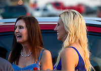 Aug. 29, 2013; Avon, IN, USA: NHRA driver Courtney Force (right) with mother Laurie Force at the premiere of Snake & Mongoo$e at the Regal Shiloh Crossing Stadium 18. Mandatory Credit: Mark J. Rebilas-