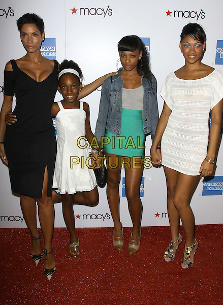 NICOLE MITCHELL MURPHY & Daughters. 27th Annual Macy's Passport Fashion Show Benefit - Arrivals held At Barker Hangar, Santa Monica, California, USA..September 24th, 2009.full length black dress white green denim jean mother mom mum family cleavage bria.CAP/ADM/KB.©Kevan Brooks/AdMedia/Capital Pictures.