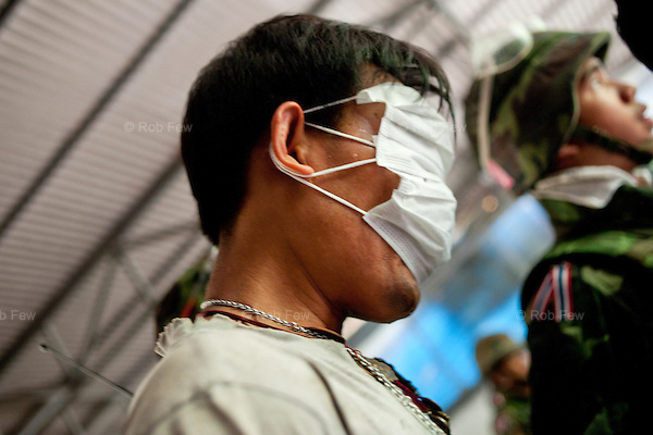 A blindfolded protestor is led away by troops during the final clearing of the main Red Shirt camp.<br />