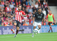 Southampton's Danny Ings under pressure from Burnley's Aaron Lennon<br /> <br /> Photographer Kevin Barnes/CameraSport<br /> <br /> The Premier League - Southampton v Burnley - Sunday August 12th 2018 - St Mary's Stadium - Southampton<br /> <br /> World Copyright &copy; 2018 CameraSport. All rights reserved. 43 Linden Ave. Countesthorpe. Leicester. England. LE8 5PG - Tel: +44 (0) 116 277 4147 - admin@camerasport.com - www.camerasport.com