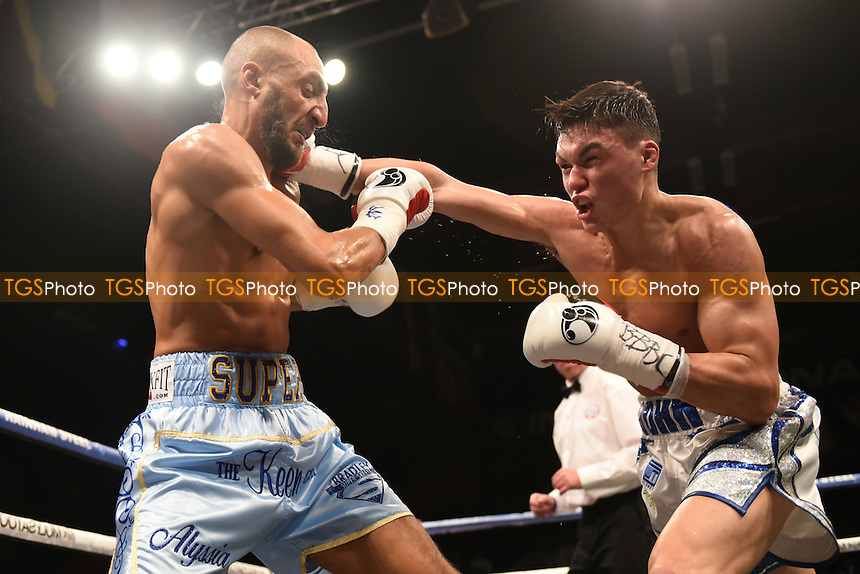 Bradley Skeete (light blue shorts) defeats John Thain to win the British Welterweight Title during a Boxing Show at the Brentwood Centre on 25th November 2016