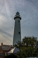 The St. Simons Light is a 104-foot brick structure completed in 1872 and was outfitted with a third-order,&nbsp;biconvex&nbsp;Fresnel lens. The lens is one of 70 such lenses that remain operational in the United States. The rotating lens projects four beams of light, with one strong flash every 60 seconds.&nbsp;A&nbsp;cast iron&nbsp;spiral stairway with 129 steps&nbsp;leads to the&nbsp;galley&nbsp;(or watch/service room. <br /> <br /> The Lighthouse is reputed to be haunted by the ghost of lightkeeper Frederick Osborne, who was killed in a duel with assistant keeper John Stephens in early March 1880. In 1934, the kerosene-burning lamp was replaced by a 1000-watt electrical light.&nbsp;On July 1, 1939, the&nbsp;United States Lighthouse Service&nbsp;was placed under the jurisdiction of the&nbsp;US Coast Guard.&nbsp;In 1953 the lighthouse was fully automated.