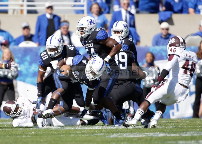 Kentucky Wildcats running back Raymond Sanders (4) during the first half of the University of Kentucky vs. Mississippi State football game at Commonwealth Stadium in Lexington, Ky., on Saturday, October 6, 2012. Photo by Tessa Lighty | Staff