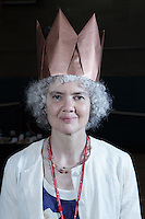 New York, NY, USA - June 24, 2011: Mélisande* (Christiane Bettens), Origami designer from Switzerland at the OrigamiUSA Convention in New York City wearing her crown folded from a hexagon of kraft paper.