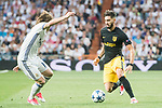 Yannick Ferreira Carrasco (r) of Atletico de Madrid competes for the ball with Luka Modric of Real Madrid during their 2016-17 UEFA Champions League Semifinals 1st leg match between Real Madrid and Atletico de Madrid at the Estadio Santiago Bernabeu on 02 May 2017 in Madrid, Spain. Photo by Diego Gonzalez Souto / Power Sport Images