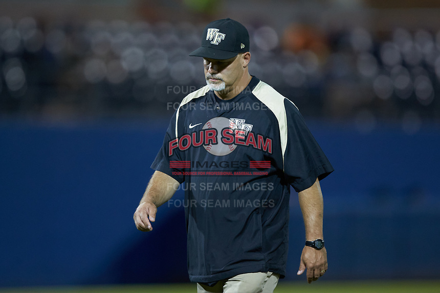 Wake Forest Demon Deacons trainer Jeff Strahm walks off the field during the game against the Florida Gators in Game Three of the Gainesville Super Regional of the 2017 College World Series at Alfred McKethan Stadium at Perry Field on June 12, 2017 in Gainesville, Florida. The Gators defeated the Demon Deacons 3-0 to advance to the College World Series in Omaha, Nebraska. (Brian Westerholt/Four Seam Images)