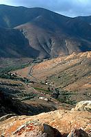 Road winding through  the Fuerteventura countryside. Betancuria, Fuerteventura, Canary Islands.
