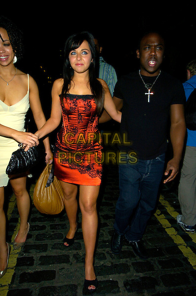 TUPELE DORGU, LOUSIA LYTTON & MOHAMED GEORGE.The Devaux Burlesque Party, Jewel Maiden Lane, London, England..September 11th, 2007.full length black skirt corset basque lingerie red skirt lace clutch purse bag purse yellow holding wrist t tee shirt jeans denim .CAP/CAN.©Can Nguyen/Capital Pictures