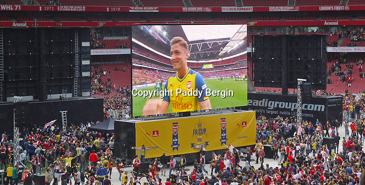 Olivier Giroud, one of the goal scorers,  celebrating the FA Cup win, seen on the big screens at the Emirates Stadium.<br /> <br /> Arsenal beat Aston Villa 4-0 at Wembley with goals from Walcott, Sanchez, Mertesacker and substitute Olivier Giroud.<br /> <br /> Stock Photo by Paddy Bergin