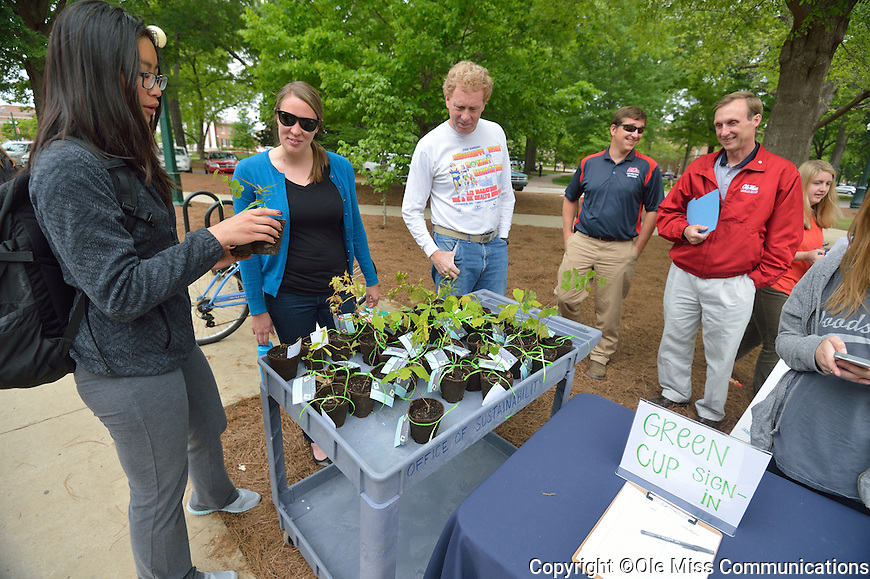 The Office of Sustainability and Landscaping Services give away seedlings that were born in the Grove to students, faculty and staff as part of the annual Arbor Day celebration.  Photo by Kevin Bain/Ole Miss Communications