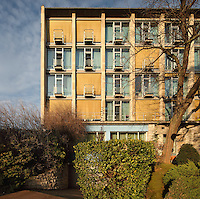 Facade of bedrooms with balconies, in the Maison de L'Allemagne or Germany House, or Maison Heinrich Heine, designed by Johannes Krahn, 1908-1974, and opened in 1956, in the Cite Internationale Universitaire de Paris, in the 14th arrondissement of Paris, France. The CIUP or Cite U was founded in 1925 after the First World War by Andre Honnorat and Emile Deutsch de la Meurthe to create a place of cooperation and peace amongst students and researchers from around the world. It consists of 5,800 rooms in 40 residences, accepting another 12,000 student residents each year. Picture by Manuel Cohen. Further clearances may be requested.