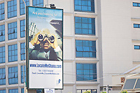 Advertising for LocateMeGhana, High Street, Accra. Ghanaian businesses are moving online.