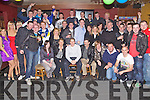 21ST BASH: Thomas Moloney, East Commons, Ardfert (seated centre,) having a blast at his 21st bash held in the Abbey Tavern, Ardfert, on Saturday night with family and friends.