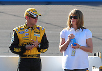 Apr 17, 2009; Avondale, AZ, USA; NASCAR Sprint Cup Series driver Matt Kenseth with wife Katie Kenseth during qualifying for the Subway Fresh Fit 500 at Phoenix International Raceway. Mandatory Credit: Mark J. Rebilas-