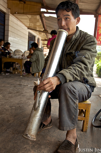A man smokes water pipe in Yunnan province