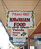 Storefront signs in downtown Hilo, on the Big Island of Hawaii. Photo by Kevin J. Miyazaki/Redux