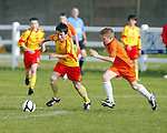 14/10/2012 Conor McDaid of Avenue United skips past Jake Ross of Coole FC in the ESB Moneypoint U-12 Cup Final at the County Ground on Sunday. Pic: Don Moloney/Press 22