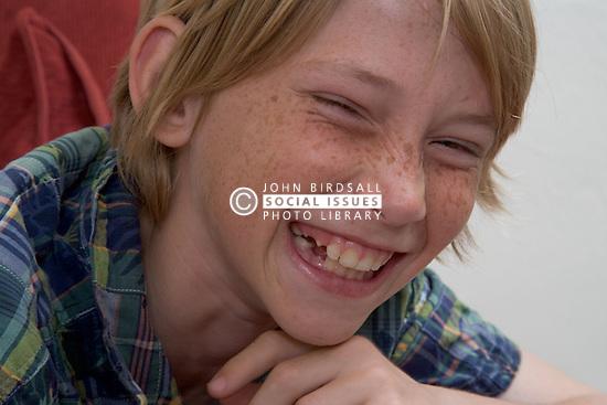 Teenager boy laughing,