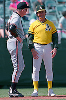 PHOENIX, AZ - Manager Roger Craig of the San Francisco Giants chats with manager Tony La Russa of the Oakland Athletics during a spring training game at Phoenix Municipal Stadium in Phoenix, Arizona in 1992. Photo by Brad Mangin