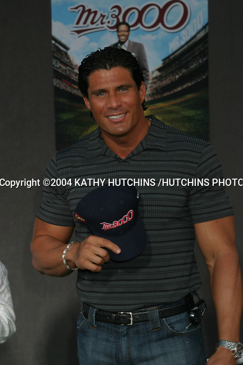 """©2004 KATHY HUTCHINS /HUTCHINS PHOTO.PREMIERE OF """"MR. 3000"""".HOLLYWOOD, CA.SEPTEMBER 8, 2004..JOSE CONSECO"""