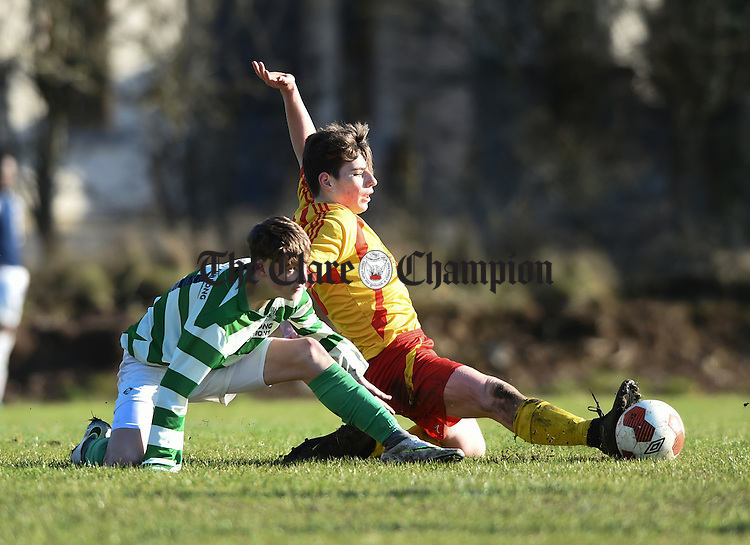 Cameron Power of Villa, Waterford  in action against Ronan Lonigan of Avenue during their  FAI U-17 cup  semi-final in Roslevan. Photograph by John Kelly.