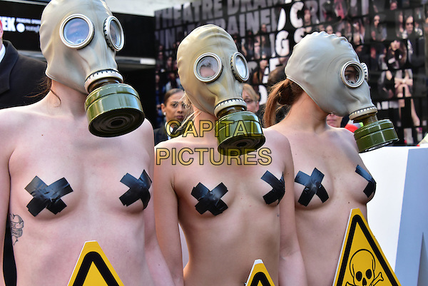 FEB 19, London  PETA demo at London Fashion Week opening.<br /> PETA highlights toxins in animal skins at London Fashion Week. A trio of nearly naked models dressed in little more than knickers and gas masks braved the cold on Brewer Street at the official opening of London Fashion Week. The striking PETA supporters will remind attendees that fur clothing and accessories are cruel to animals and toxic to humans. London, England February 19,  2016.<br /> CAP/JOR<br /> &copy;JOR/Capital Pictures