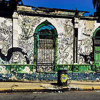 A ruined house with Spanish colonial architecture elements, painted over by a local artist, is seen in the center of San Salvador, El Salvador, 12 November 2016.