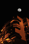 Kaohsiung Taiwan -- Large moon over a residential building.<br /> <br /> According to ancient Chinese stories, a rabbit lives on the moon. With a bit of imagination, the outline of a 'rabbit' shape is indeed visible on the lunar surface!
