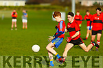 Kieran Dennehy of ISK Killorglin on the ball as Conor Quirke of Bishopstown bears down on him, in the Frewen Cup in Currans on Friday.