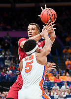 NWA Democrat-Gazette/CHARLIE KAIJO Arkansas Razorbacks forward Daniel Gafford (10) defends the ball from Florida Gators guard KeVaughn Allen (5) during the Southeastern Conference Men's Basketball Tournament quarterfinals, Friday, March 9, 2018 at Scottrade Center in St. Louis, Mo.