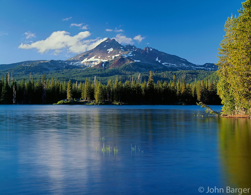 ORCAC_054 - USA, Oregon, Deschutes National Forest, South side of Broken Top rises above coniferous forest and Sparks Lake in evening.