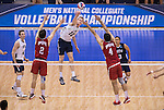 07 MAY 2016: Jake Langlois (10) of Brigham Young University splits Ohio State University defenders with a kill during the Division I Men's Volleyball Championship held at Rec Hall on the Penn State University campus in University Park, PA.  Ohio State defeated BYU 3-1 for the national title.  Ben Solomon/NCAA Photos