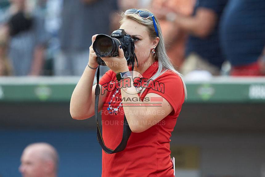 Charlotte Knights team photographer Laura Wolff hard at work during the International League game against the Durham Bulls at BB&T BallPark on July 4, 2018 in Charlotte, North Carolina. The Knights defeated the Bulls 4-2.  (Brian Westerholt/Four Seam Images)