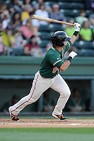 Second baseman Avery Romero (1) of the Greensboro Grasshoppers bats in a game against the Greenville Drive on Wednesday, May 7, 2014, at Fluor Field at the West End in Greenville, South Carolina. Romero is the No. 9 prospect of the Miami Marlins, according to Baseball America. Greenville won, 12-8. (Tom Priddy/Four Seam Images)