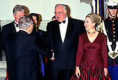Chancellor Helmut Kohl of Germany, center, shakes hands with a guest as first lady Hillary Rodham Clinton, right, looks on as she and United States President Bill Clinton host an Official Dinner in the Chancellor's honor at the White House in Washington, DC on Thursday, February 9, 1995.<br /> Credit: John Harrington / Pool via CNP
