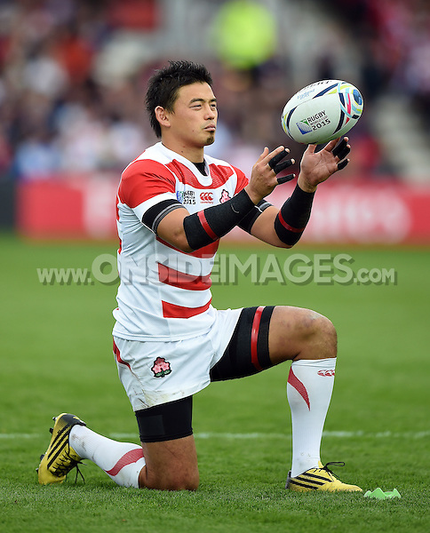 Ayumu Goromaru of Japan lines the ball up for a kick at the posts. Rugby World Cup Pool B match between Scotland and Japan on September 23, 2015 at Kingsholm Stadium in Gloucester, England. Photo by: Patrick Khachfe / Onside Images